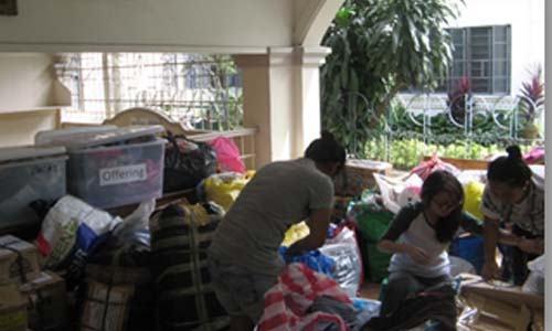 The members of High School Student Government takes part in the packing and re-packing of goods.