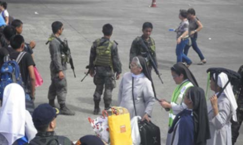 The school president, Sr. Mary Thomas Prado, OSB, and the Prioress of the Community of Benedictine Sisters, Mother Adelaida Ygrubay, OSB oversee the smooth and efficient delivery of relief goods at Tacloban Airport.