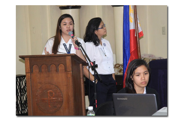 BS Psych sophomores Carla Isabel Castro and Nikka Andrea Matibag explain the effects of artoons on the behavior of children based on a study they conducted.