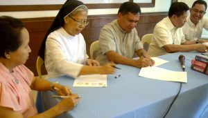 Sr. Celine signs the CBCMM MOA for St. Scholastica's College