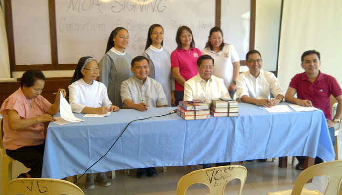 Books are donated to the parochial school of Tagbilaran as part of Yakap Eskwela Program.