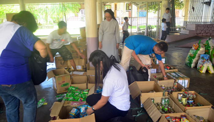 February 21, 2018, St. Agnes academy,Legaspi City, Albay, sorting out goods for the distribution of relief bags