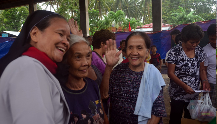 February 20, 2018, Camalig, Albay, Sr. Mary Frances exchanging warm moments with the senior citizens