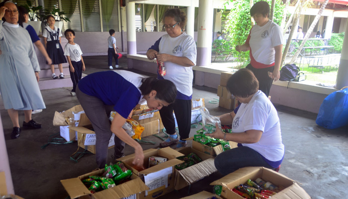 Febr. 21, 2018, St. Agnes Academy, Legaspi City, Albay, packing the goods for the evacuees