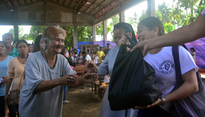 February 21, 2018, Camalig, Albay, Sr. mary Frances Dizon, OSB, distributing the relieg bags
