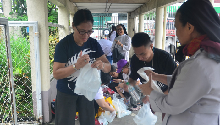 February 20, 2018, St. Agnes Academy, Legaspi City, Albay, preparing the merienda packs for the senior citizens in the evacuation center