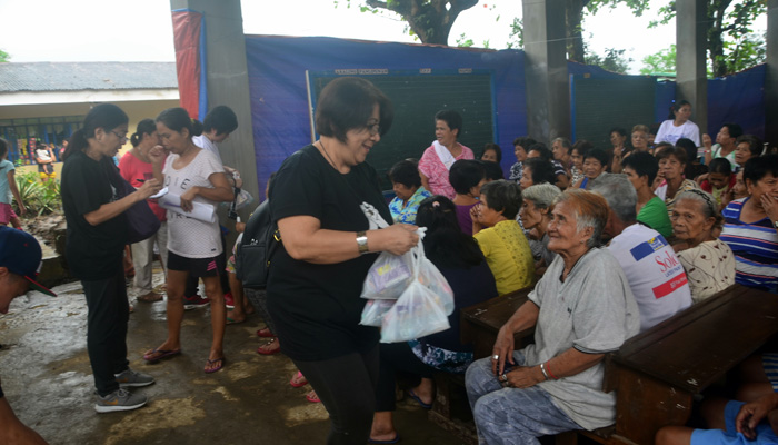February 20, 2018, distributing the merienda packs to the senior evacuees