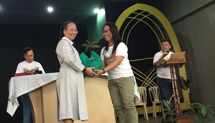 September 1, 2018, Sr. M. Rosario Obiniana, OSB receives a Kamagong Tree for SSC.