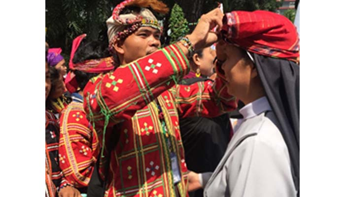 Oct. 12, 2018 Salubong of the Lumads and the Benedictine Community. Sr. Theody Bilocura, OSB ia given a tubao.