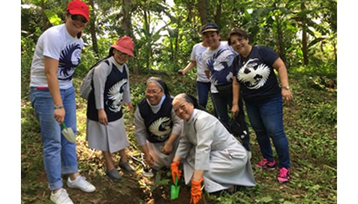 Oct. 25, 2018,  Sr. M. Christine Pinto, OSB and Sr. M. Rosario  Obiniana, OSB plant the Kamagong tree given during launching of the Season for Creation last Sept. 1, 2018