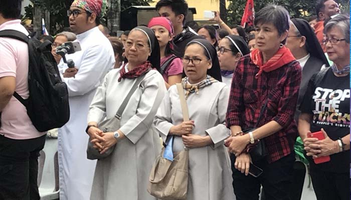 Jan. 25, 2019 Rally by the religious groups calling for peace. In photo are Sr. M. Rosario Obiniana, OSB and Sr. Andrea Ecito, OSB