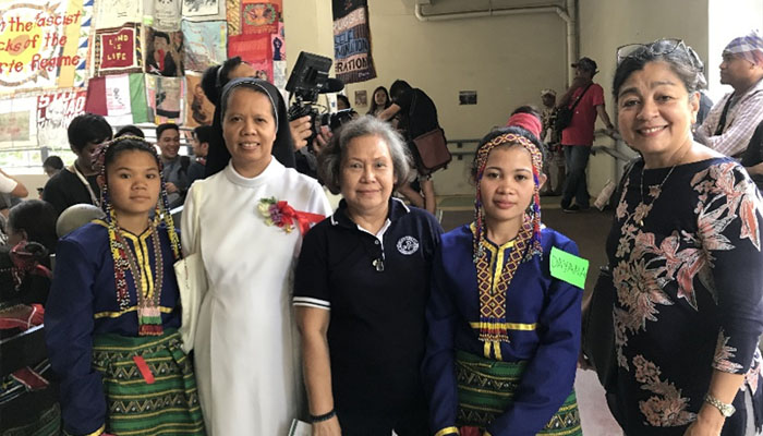 March 29, 2019 Sr. Theodora Bilocura, OSBG and , Becky P. Marquez as parents for the Lumad Bakwit School graduating students held at the UP Integrated School