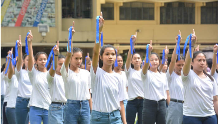Senior high school students gesture to oneness before their performance during Community Day last December 9 at the field.